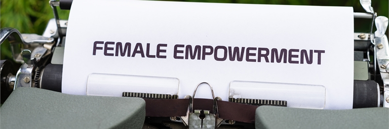 Typewriter with a piece of paper that reads 'FEMALE EMPOWERMENT'